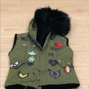 forest green army themed vest with black fo fur